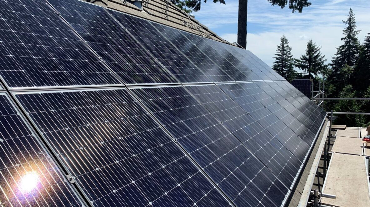 A close look of solar panel system on a concrete tile roof