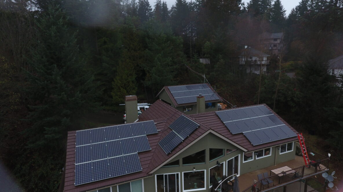 Installing solar panels on house rooftops in Malahat, BC