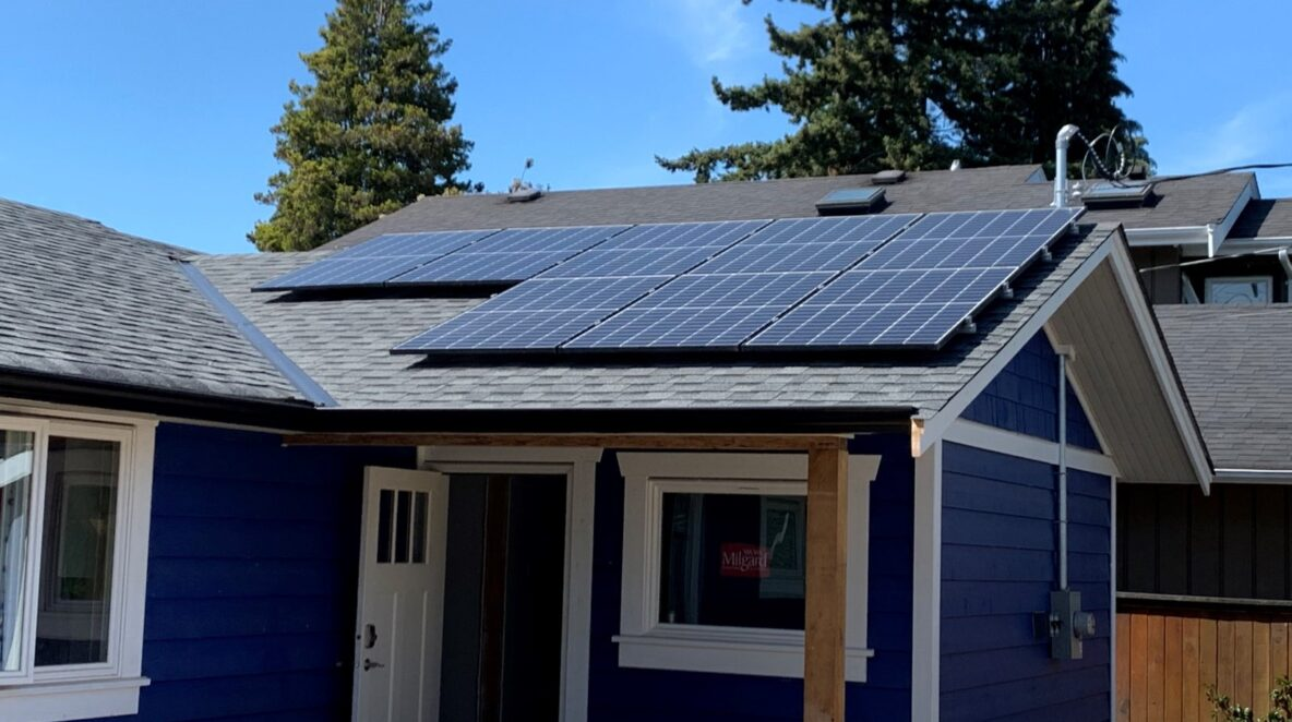 A residential home roof has one side of solar panels