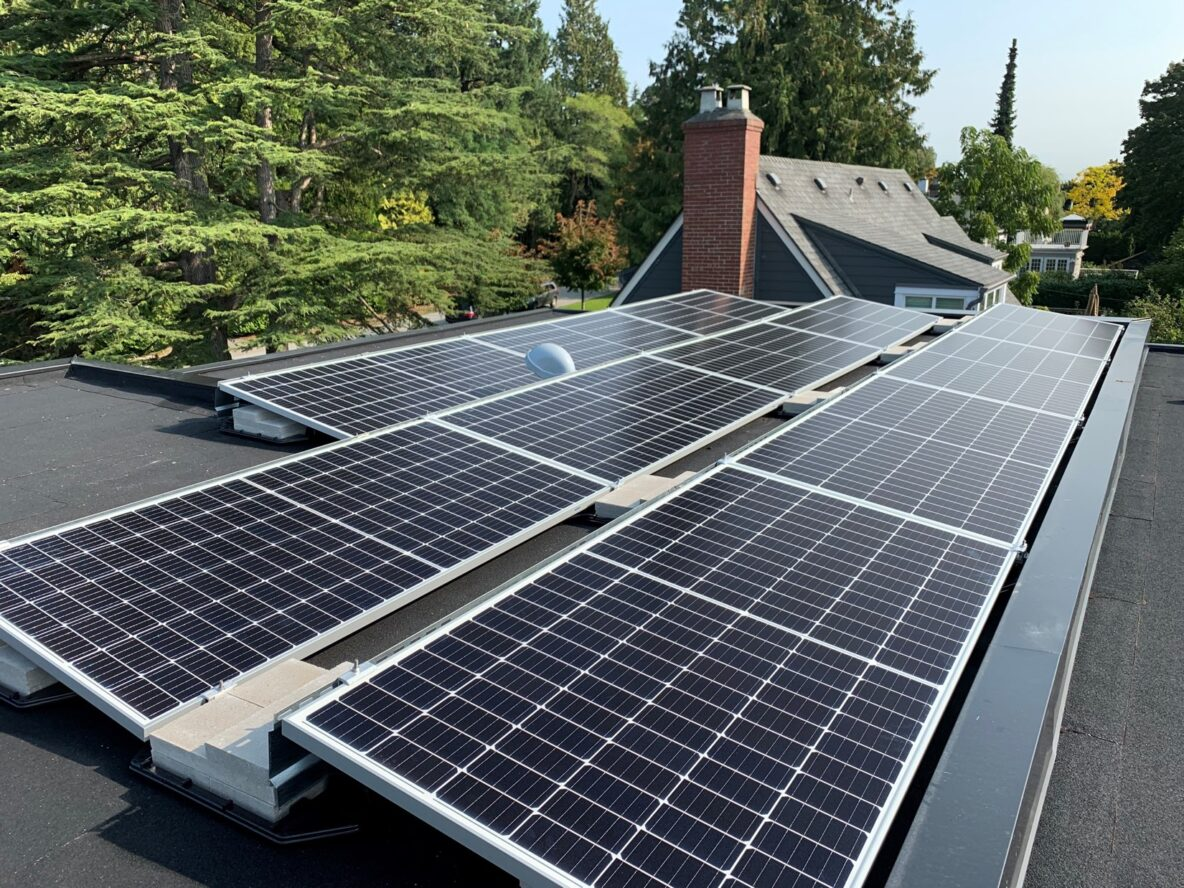 Close look of solar panels on the flat roof